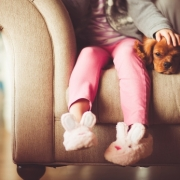 girl with slippers and puppy