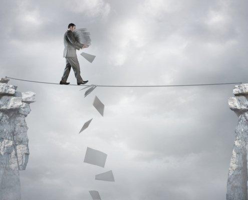 man balancing bills